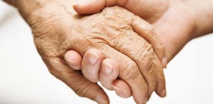 Parkinsons disease and massage, picture of hands touching