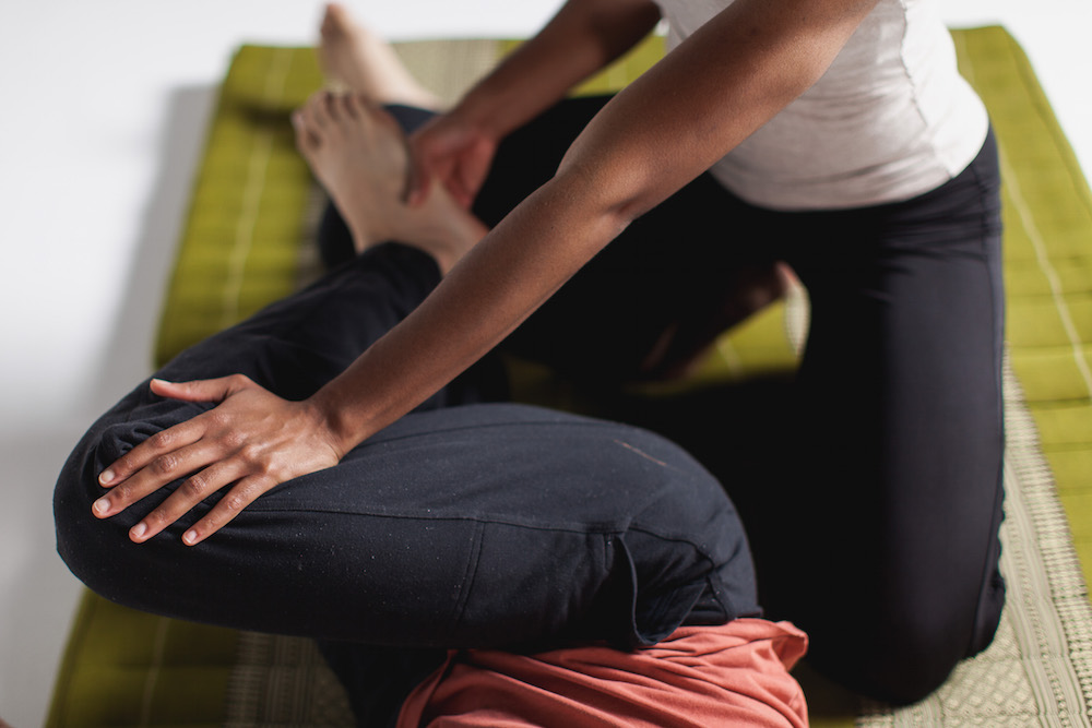 Thai massage gentle twist in supine