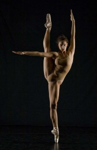 perfectly balanced dancer with imbalanced weight distribution and limb position